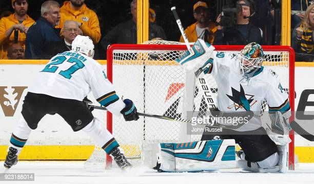 A shot by Mattias Ekholm of the Nashville Predators beats Aaron Dell of the San Jose Sharks for a goal during an NHL game at Bridgestone Arena on...