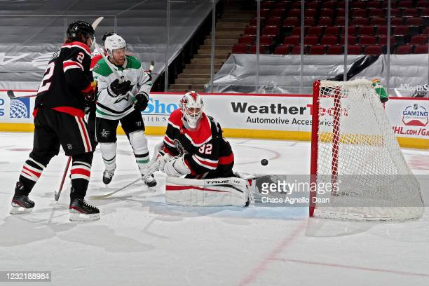 Shot by Miro Heiskanen of the Dallas Stars goes by Kevin Lankinen of the Chicago Blackhawks for a goal in the second period at the United Center on...