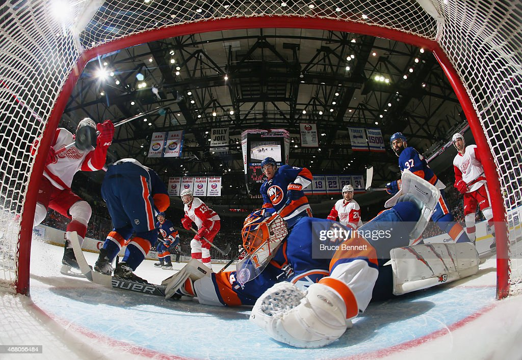 A shot by Pavel Datsyuk #13 of the Detroit Red Wings gets past Jaroslav Halak #41 of the New York Islanders at 10:13 of the second period at the Nassau Veterans Memorial Coliseum on March 29, 2015 in Uniondale, New York.