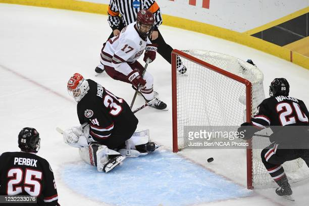 Shot by Philip Lagunov of the Massachusetts Minutemen trickles past David Hrenak of the St. Cloud State Huskies for a goal in the second period...