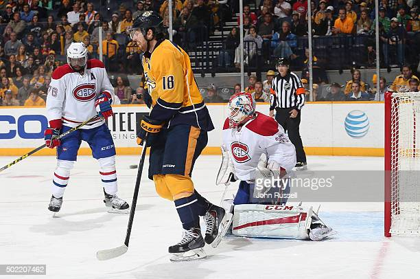 A shot by Roman Josi of the Nashville Predators finds the net as Predators James Neal screens goalie Dustin Tokarski of the Montreal Canadiens during...