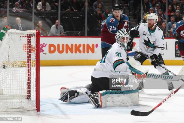 A shot by Tyson Barrie of the Colorado Avalanche passes goaltender Martin Jones of the San Jose Sharks at the Pepsi Center on January 2 2019 in...