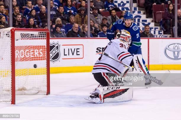 A shot by Vancouver Canucks Winger Sam Gagner gets past Chicago Blackhawks Goalie Anton Forsberg for a goal during their NHL game at Rogers Arena on...