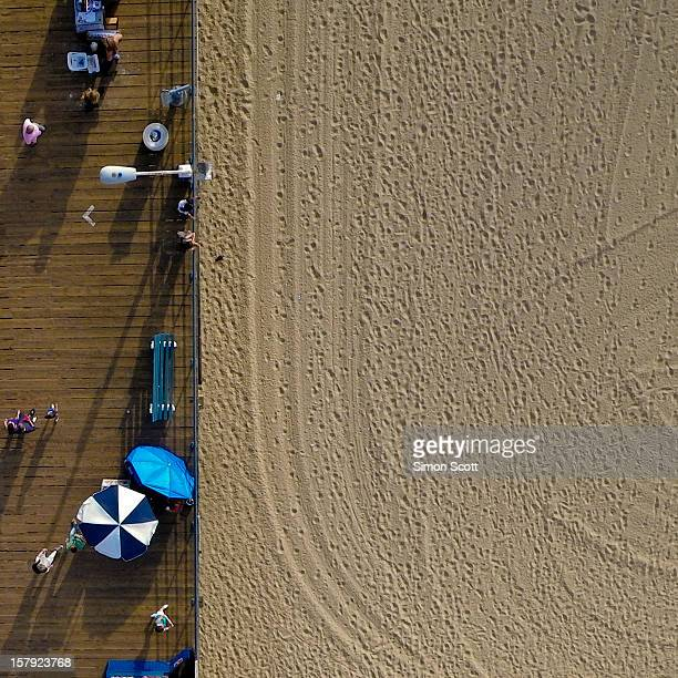 Shot from a kite, my camera captured a piece of history, the footsteps and marks made by hundreds that enjoyed the beach that day. The pier in Santa...