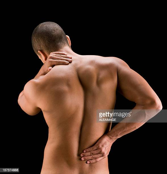Shot from behind of a man clutching his aching back and neck