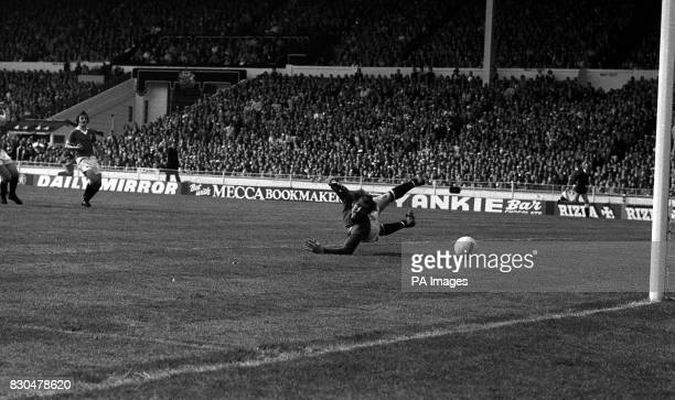 A shot from Bobby Stokes flashes past Manchester United's goalkeeper Alex Stepney to give Second Division Southampton the lead and eventual victory...