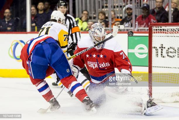 A shot from Pittsburgh Penguins center Evgeni Malkin passes Washington Capitals goaltender Braden Holtby during a NHL game between the Washington...