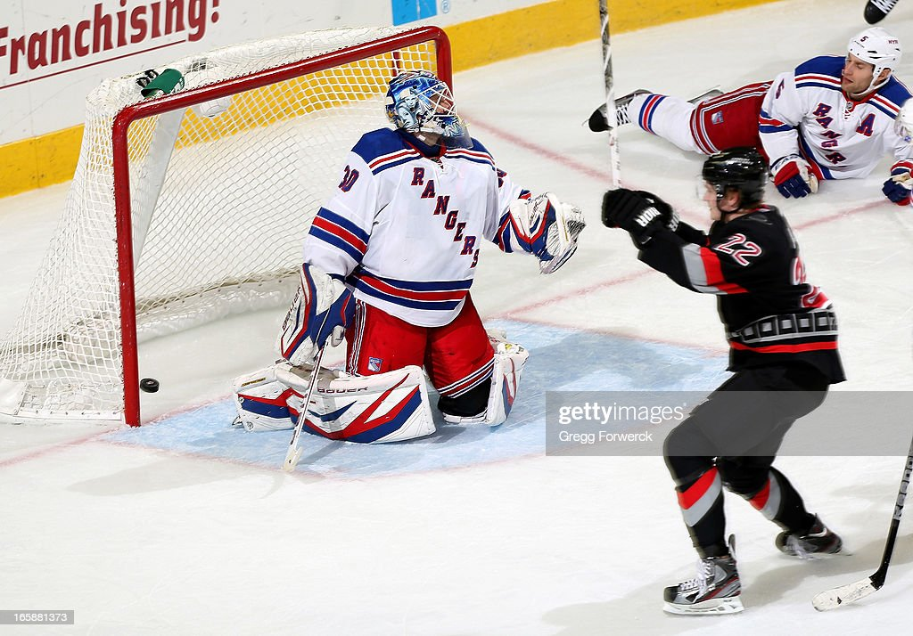 A shot from Zac Dalpe #22 of the Carolina Hurricanes finds the back of the net past goaltender Henrik LUndqist #30 of the New York Rangers during their NHL game at PNC Arena on April 6, 2013 in Raleigh, North Carolina.
