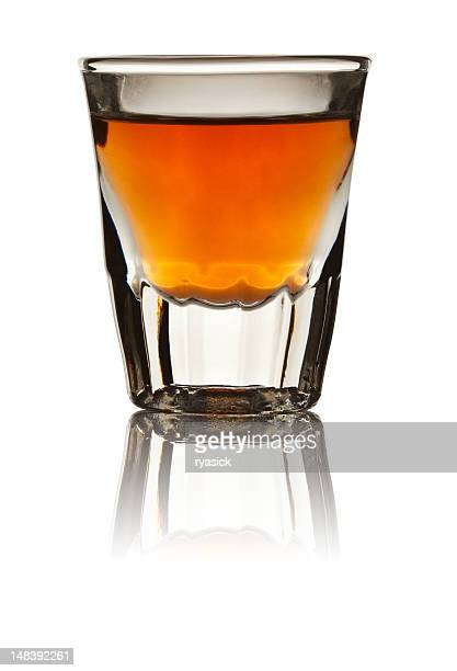 Shot Glass Filled with Whiskey Isolated on White
