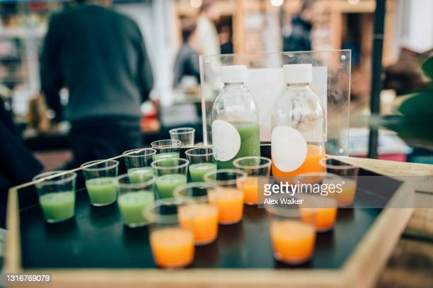 shot glasses with vibrant coloured juice at a food tasting - drink stock pictures, royalty-free photos & images