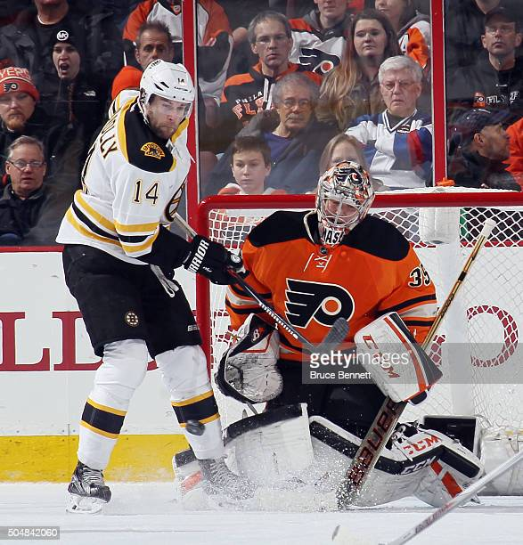 A shot hits off the leg of Brett Connolly of the Boston Bruins as he attempts to deflect it past Steve Mason of the Philadelphia Flyers during the...