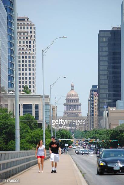 Shot looking northward on Congress Ave. In Downtown Austin, Texas on a hot late spring day.