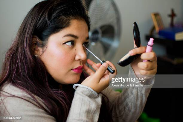 Shot of a beautiful woman applying makeup.
