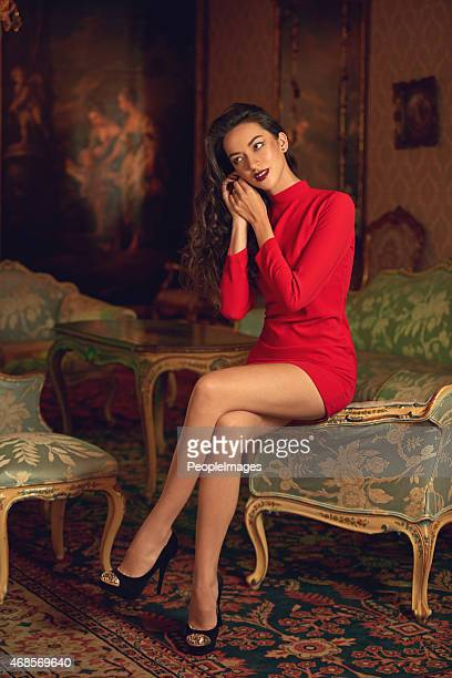 beauty and riches - red dress stock photos and pictures