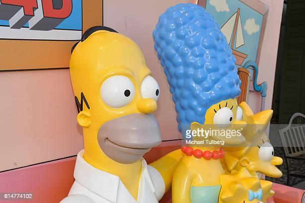 Shot of a Homer Simpson Marge Simpson and Lisa Simpson statue at a celebration of the 600th Episode of The Simpsons at YouTube Space LA on October 14...