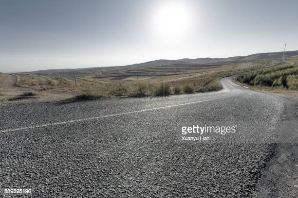 Shot of a long open road stretching out far away into the distance