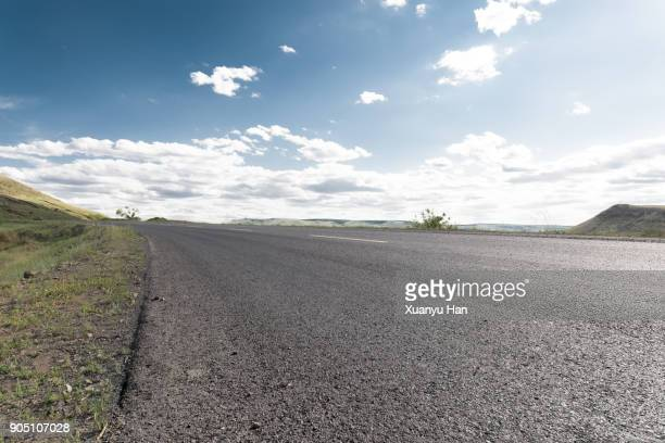 shot of a long open road stretching out far away into the distance - low angle view stock pictures, royalty-free photos & images