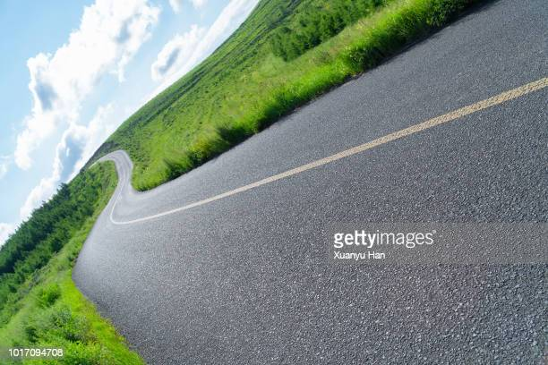 shot of a open road stretching out far away into the distance - slanted stock photos and pictures