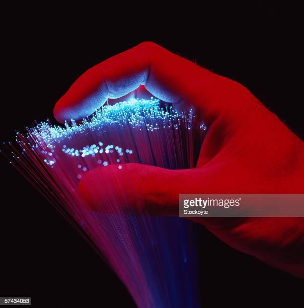 shot of a person holding fiber optics