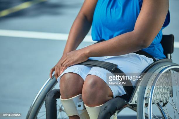 shot of a unrecognizable female wheelchair basketball player on an outdoor court - basketball uniform stock pictures, royalty-free photos & images