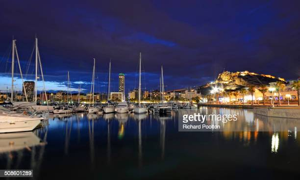 A shot of Alicante's Castle reflected in the still water of the port