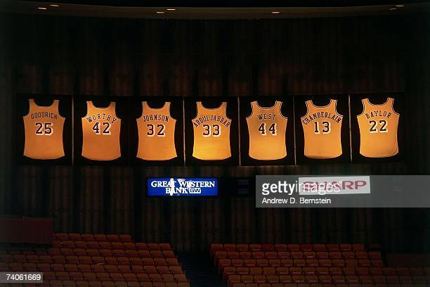 Shot of all the retired jerseys in the Los Angeles Lakers history that hang from the rafters at the Great Western Forum prior to a Lakers game on...