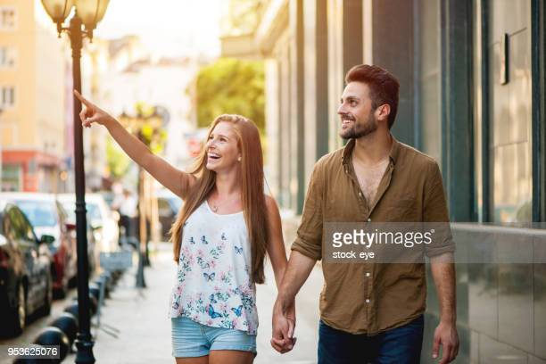 Shot of an affectionate young couple walking together in the city