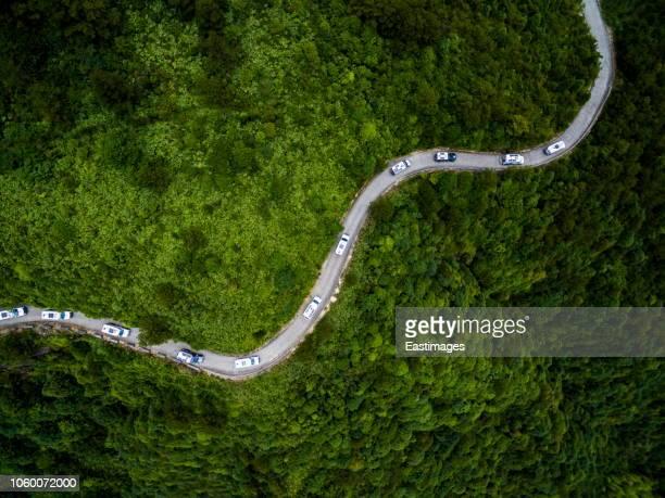aerial shot of car car drive on mountain road /fujian, china - fujian stock photos and pictures
