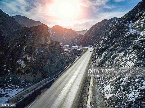 AERIAL shot of highway runs through Tian Shan,Xinjiang,China.