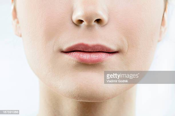 shot of lower half of woman's head - lips stock pictures, royalty-free photos & images
