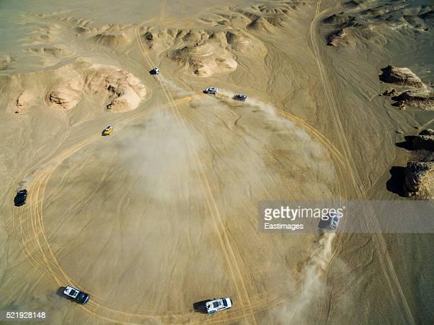 WS AERIAL shot of off-road vehicles driving in Gobi./Xinjiang,China.