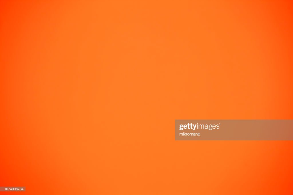 Shot Of Orange Colored Paper Background : Stock Photo