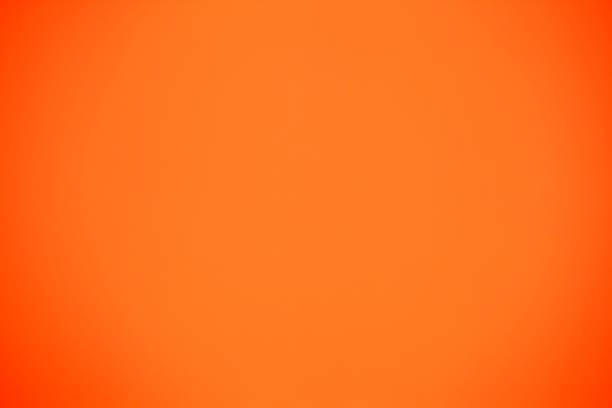 shot of orange colored paper background - 彩色影像 個照片及圖片檔