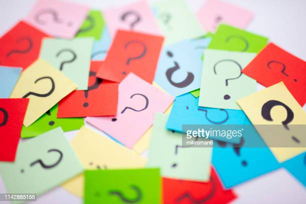 shot of question marks on colorful adhesive notes - q and a stock pictures, royalty-free photos & images