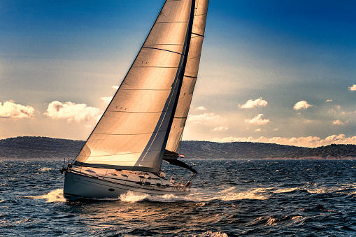 Shot of Sailing Boat Agains the Sunlight 1145669216