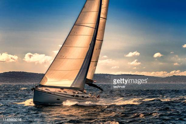 shot of sailing boat agains the sunlight - sailor stock pictures, royalty-free photos & images