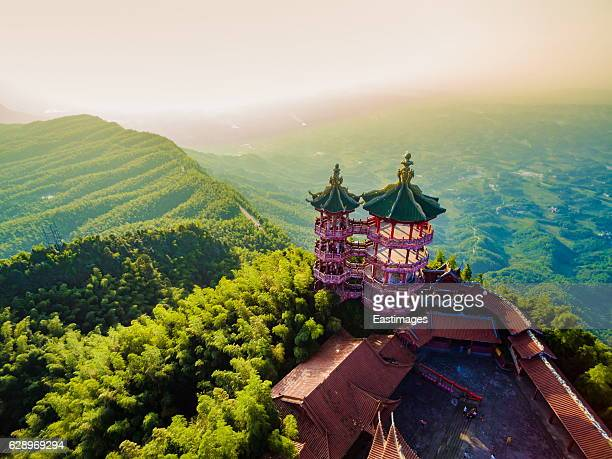 AERIAL shot of Temple on top of mountain at sunset
