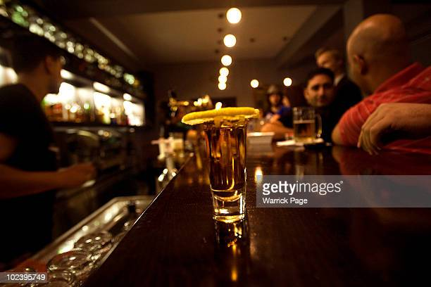 A shot of tequila and a slice of lemon sit on the bar of Beit Aneeseh on June 25 2010 in Ramallah West Bank Nightlife in Ramallah is on the rise as...
