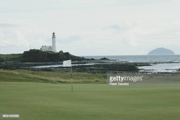 Shot of the 10th green at Turnberry golf club in Ayrshire Scotland with the lighthouse and Ailsa Craig in the distance 2013
