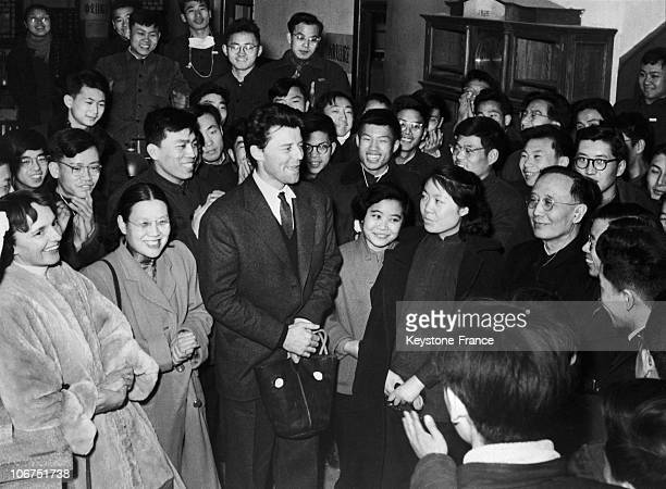 Shot Of The French Actor Gerard Philipe And His Wife Anne Surrounded By Young Chinese Students At Peking On March 27 1957 The Artist Was Visiting...