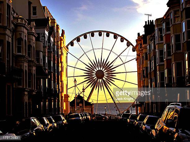 CONTENT] Shot of the new Ferris wheel affectionately named the Brighton eye Picture take at sunset with the perspective of the road an terraced...