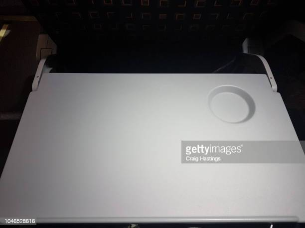 Shot of tray table down on economy flight night highlight plain clear airline