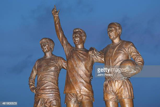 Shot of United Trinity statue featuring George Best, Denis Law and Bobby Charlton, ahead of the Barclays Premier League match between Manchester...