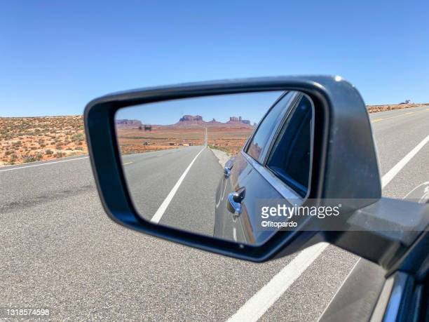 shot of valley of the gods from the side mirror of a car - fitopardo stock pictures, royalty-free photos & images