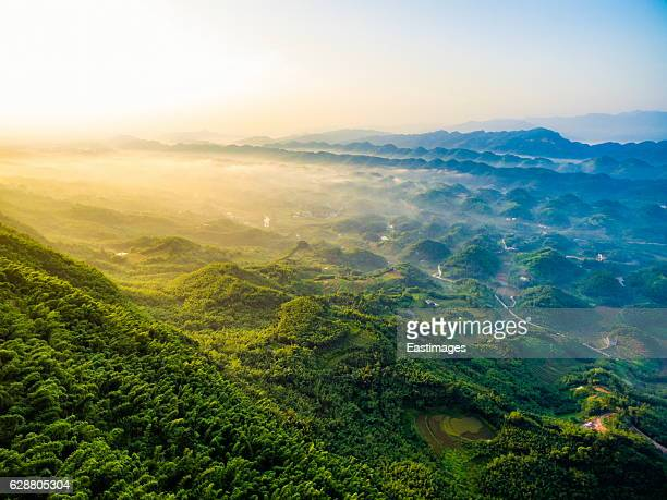 aerial shot of village house nearby bamboo forest at sunset,sichuan,china. - chongqing stock photos and pictures
