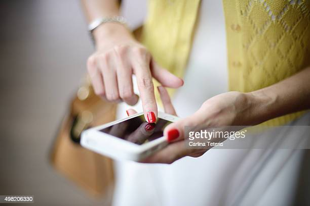 Shot of woman's hands using the phone