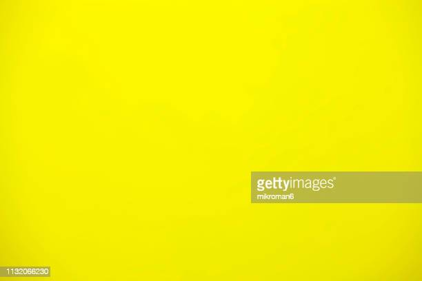 shot of yellow paper background - yellow background stock pictures, royalty-free photos & images