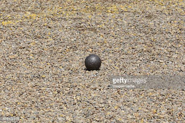 Shot Put Ball after being thrown at a track and field event