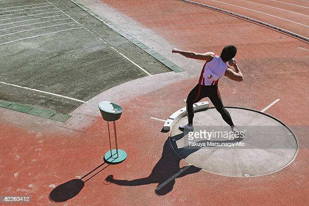 shot putter getting ready to throw - shot put stock pictures, royalty-free photos & images