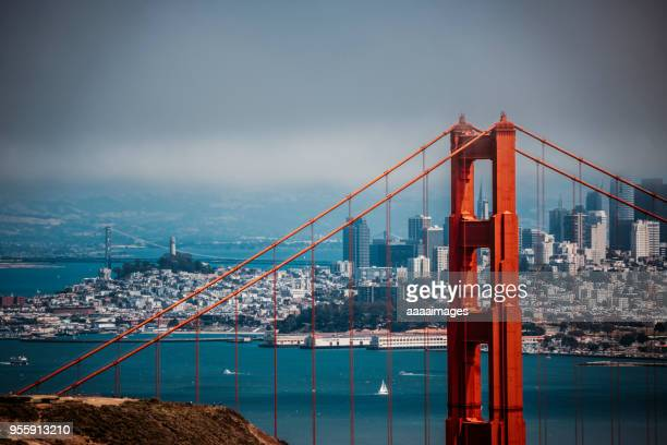 shot san francisco city skyline with golden gate bridge on foreground - san francisco california foto e immagini stock